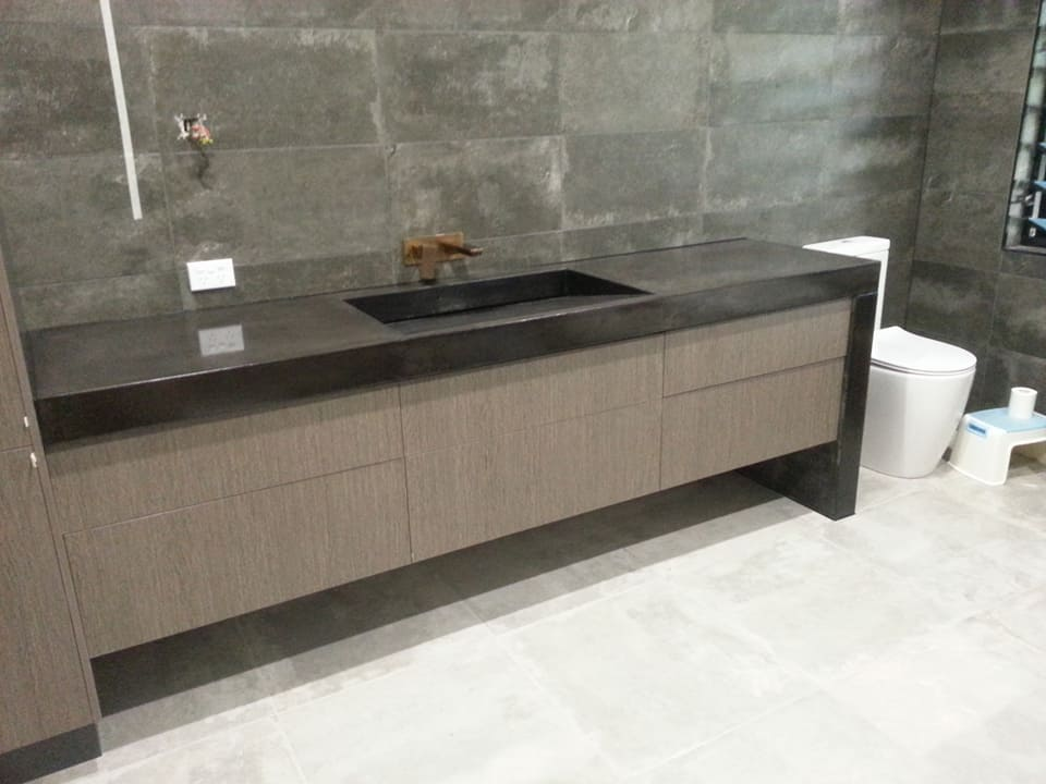 Black concrete vanity waterfall edge