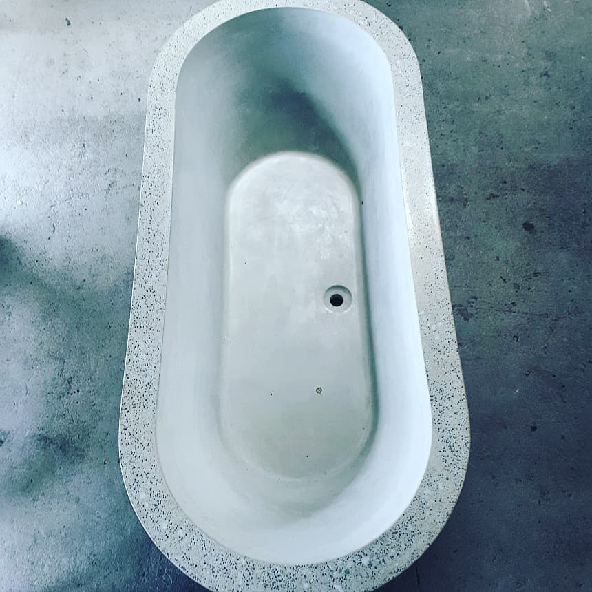 white concrete bathtub thick exposed rim