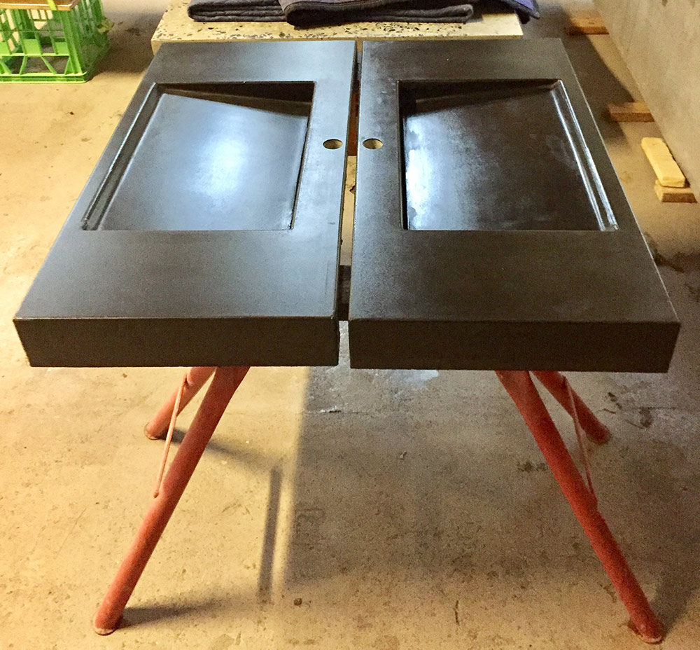 Twin black concrete vanities